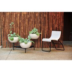 Bring pure and sculptural form of the Case Study Ceramic Bowls with Tri-Stand to your home or patio!