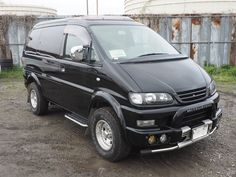 I won this last week at auction. 2000 Mitsubishi Delica, Crystal lite roof, small lift, wheel flares, heated seats, Navi.