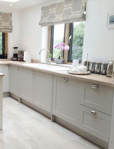 Modern country style shaker kitchen, with cabinet doors from the paintable door range finished in Farrow & Ball Cornforth White.