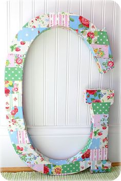 DIY:: decoupage with paper onto giant letter..cute