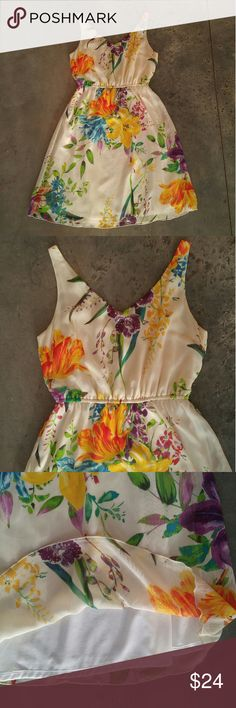Old Navy Colorful Floral Sundress Old Navy dress, size small, in excellent condition! This dress screams summer! Gorgeous colorful floral print. Elastic waist, v front, v back, fully lined. Please ask any questions. No trades. Make a reasonable offer. Thanks! Old Navy Dresses Mini