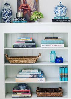 Blue and white bookshelves.