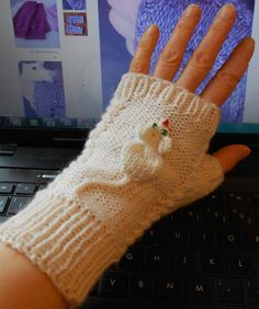 Free Knitting Pattern for Squeaky Mitts - Melanie Gall's gerbil-inspired motif can be used on fingerless mitts and mittens but also has been adapted for hats and more. Pictured project by mimouna