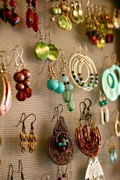 I made one like this.  Got the screen at Lowe's, cut it to fit some wooden frames and stapled it on.  Easy earring holder!!  (Makes great gifts, too).