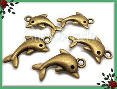 10 Antiqued Brass Playful Dolphin Charms 23mm by sugabeads on Etsy