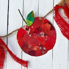 DIY Recycled Apple Bunting Make a fun fall garland to celebrate the season this year. Use up some old scrapbook paper scraps and add Mod Podge.