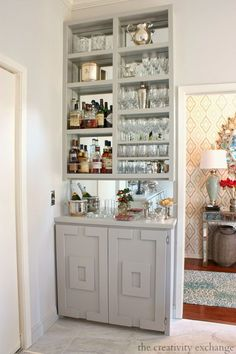 A small space, built in, mirrored bar.