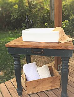 Up-cycled rustic style bathroom vanity made from and old set of dining table legs.  Love re-purposing furniture!