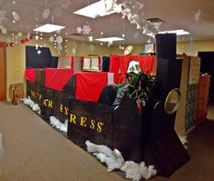 For this years annual Christmas contest in our office, my coworkers decorated their cubicles to look like the train from The Polar Express!