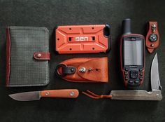 Some orange stuff out of my pockets today back from IWA.  #iwa #iwa2016 #safetyorange #littlefixed #bokerknives #gps #bladearmour #modularcompass #uagcover #everydaycarry #everydaycarryknife #fixie #pocketdump #pocketcarry #pocketknife #handmade #handdump #geardump #edc #essentials #edcgear #edcpocketdump #todayedc #alwayscarry #skull #Leatherman #custom #modularequipment