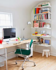 Colourful shelves in a home office.