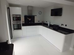 This monochrome kitchen is ultra sleek with Handleless White Gloss units and black worktops. The martini splash splashback is a nice, designer-like touch! White Kitchen Units, White Kitchen Decor, White Kitchen Black Worktop, Black Kitchens, White Gloss Kitchen, Gloss Kitchen, Black Kitchen Decor, Black White Kitchen Decor, White Kitchen Design