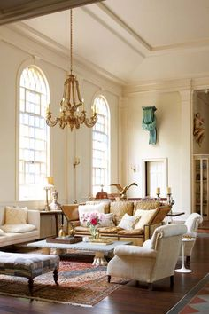 The living room retains vestiges of its former life as a church with its high ceilings and subtly stained glass windows. Very well decorated