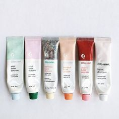 Glossier did a collab with Milk Bar to turn birthday cake into balm form. Read more for my Glossier Birthday Balm Dotcom review, swatches  #HairBeauty