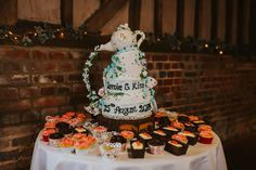 Isn't this cake amazing! Plus yummy cup cakes for guests to try. @LillibrookeMnr Photo by Benjamin Stuart Photography #weddingphotography #weddingcake #cupcakes #caketeapot #weddingideas #cake #bespokecakes