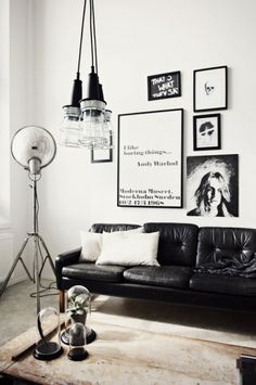 Black living reverse it mostly black with white accents and white frames and couch.