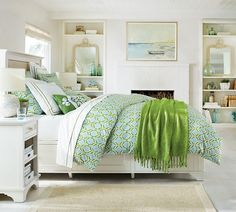 A geo pattern comforter in green and blue add a sense of freshness to any bedroom.
