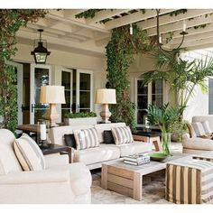 Honeysuckle climbs the trellis of actor Hank Azaria's outdoor living room, which is furnished with Trip Haenisch-designed seating upholstere...