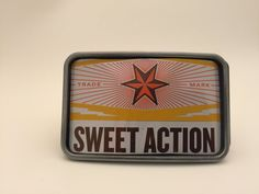Sweet Action by Sixpoint Brewery upcycled Beer Belt Buckle. It is the logo from the beer can inserted onto a 3 x 2 antique silver colored