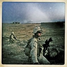 In Zolmabad, two Marines keep watch in January.