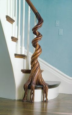 Hand-crafted bannister — The starting newel post was hand-carved by North Road's Michael Kennedy and modeled after a National Geographic photo of a tropical strangler fig tree with raveling, cascading roots. Carving and installing the handrail required about 800 man-hours, the entire stair project took nearly 3000 hours.