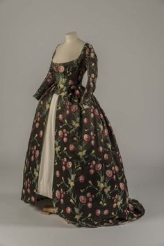 c. 1748 (alteted ca 1780) gown of black silk with brocaded floral motifs. Note, the black has faded to brown. It was impossible to dye any textile true black until chemical dyes were invented in the mid 19th century. Further, black natural dyes were very harsh and literally disintegrated fibers over time. Thus, its rare to find any intact black textile made before the mid 19th century.