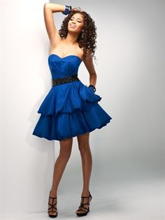 P5665 - Simply flirty.  Strapless short taffeta flows into tiered bubble hems.  A pop of beading accentuates the waist and added pockets provide for all your necessities.  Corset back closure for the ultimate fit.