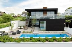 Nilsson Villa-Modern Beach House With Black and White Interior Design in Sweden