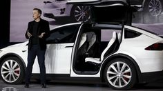 Tesla Motors CEO Elon Musk introduces the falcon wing door on the Model X electric sports-utility vehicles during a presentation in Fremont, California September Musk is helping create the perception that going green can be cool. Tesla Model X, Tesla Motors, Elon Musk Tesla, Tesla Owner, Tesla Ceo, Diy Car, Electric Cars, Electric Vehicle, Automobile