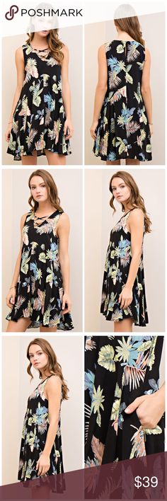 PREORDER Black fully lined strappy top swing dress Printed a-line dress featuring v-neck with strapy detail. Back keyhole withb utton closure. Side pockets. Fully-lined. Non-sheer. Woven. Lightweight. Dresses