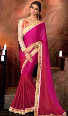 Plunge into elegance wearing this pink color net, georgette and jacquard sari. This attire is beautifully adorned with lace and resham work. #fushiacolorsarees #gamathiborderworksari #embroideredlaceworksaris