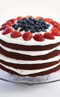 Colorful layers of red velvet cake make the perfect foundation for this Independence day dessert. Velvet Cake, Red Velvet, Blueberries, Strawberries, American Cake, Tea Time Snacks, Americas Test Kitchen, Perfect Foundation, Supper Club