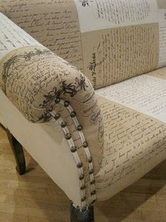 Canvas/burlap couch with caligraphy/text print.   This blog page includes a lot of other inspiring images.