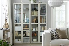 The IKEA BILLY bookshelves come in beige and other colors, and have adjustable shelves that you can move and customize according to your needs. The glass doors let you protect and display your items. Align several units for a larger storage solution