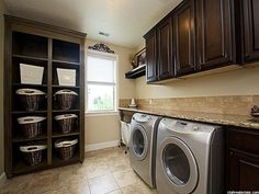 Laundry room with great storage -- love the basket organization!