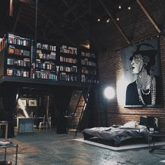 If I had a loft, it would so look like this. Is that a bookshelf up the stairs/ladder? And, the art canvas, I love it. My future house needs a loft with this layout and design. Loft Design, Design Case, House Design, Attic Design, Library Design, Studio Design, Bedroom Designs, Wall Design, Design Design