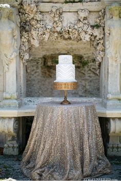 Stunning #wedding #cake presentation with a sequined tablecloth and gold cake stand.