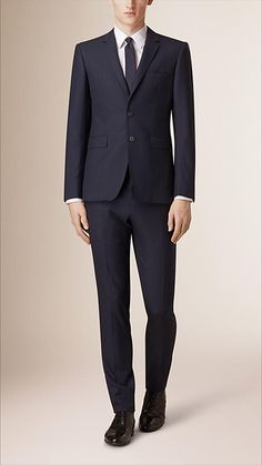 Burberry Navy Slim Fit Prince of Wales Check Suit - A slim fit suit with a short, closely fitted jacket and narrow tapered trousers, crafted in a Prince of Wales virgin wool and cashmere blend. Inspired by traditional tailoring, the suit is finished with sartorial pick-stitch detail and a melton undercollar. Discover men's tailoring at Burberry.com