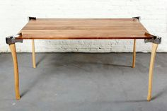 woodsman axe table by duffy london chops through the surface