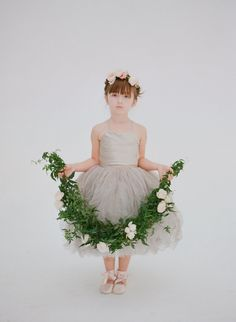 This grey short tutu flower girl gown with halter neckline is perfect for your little princess! Tea length gown with sleeveless bodice and tulle skirt perfect for boho wedding.