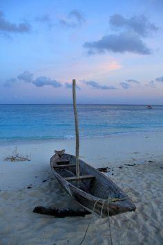 A fishing boat on the shore of Kendwa Beach in Zanzibar, Tanzania, taken just before sunrise.