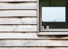 Mortehoe House is a gabled family retreat by McLean Quinlan Architects on the Devon coastline in England with walls of weathered stone and timber. Oak Cladding, Exterior Cladding, Contemporary Barn, Modern Barn, Wooden Architecture, Architecture Details, Shed Interior, Cedar Homes, Villa