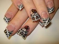 These Halloween nails are SO cute! Not sure my O.C.D. could handle the uneven and jagged lines.... But, I will try it.