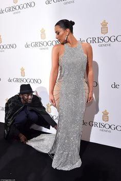 Train reaction: Kim needed some assistance to prepare her train from her chainmail dress for the black carpet