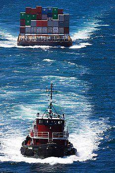 tugboat pulling container barge | Onne Van der Wal, Corbis