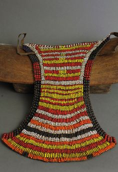 Africa | Apron (cache sexe) from the Toposa people of southeastern Sudan | Leather with glass beads