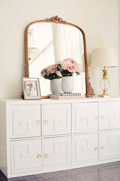 Who knew that a glam storage unit was just a DIY away? We're swooning over the thoughtful details that comprise this elegantly-crafted piece—not to mention the ornate mirror on top to match. Gold ring knobs and a fun overlay detail instantly transform the bulky unit into a stylish statement.