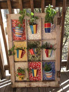 Old window + coffee mugs = mosaic garden