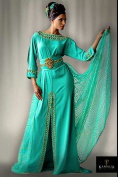 Turquoise kaftan with gold embellishments and a split skirt. Igen garb.