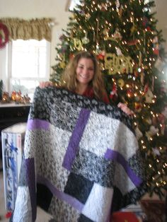 This quilt I made on request from my youngest daughter, Cori. She wanted a lavender and black and grey bedspread.